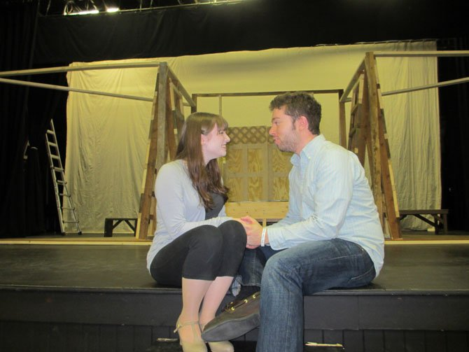 Molly Nuss, as Louisa, and Josh Goldman, as Matt, share a romantic – and musical – moment in the Vienna Theatre Company’s production of ‘The Fantasticks.’