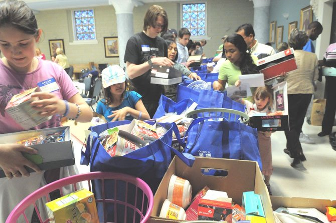Lisa Foos (left) gathers a selection of personal items and treats for a box she has just decorated.
