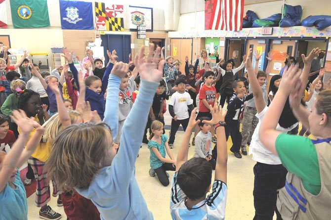 The second graders at the Arlington Science Focus School do a final tree cheer at the end of the Radio Disney program.