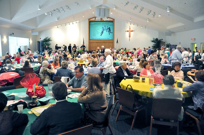 More than 500 guests dine at Floris United Methodist Church Friday, April 13 to raise money for hungry people, while a slide show with hunger facts plays.