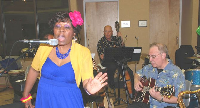 "Beverly Cosham, President of the Board of Directors of the Reston Community Orchestra, sings at ""Caribbean Night."""