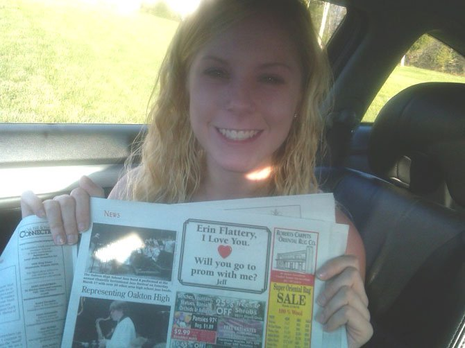 South Lakes junior Erin Flattery holds up the ad placed in The Oak Hill/Herndon Connection by her boyfriend, South Lakes senior Jeff Church, asking her to prom. Flattery happily said yes.