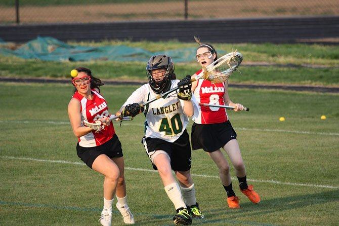 In a recent girls' lacrosse game between the Saxons and Highlanders, Langley goalie Erin Long (40) saves the ball in heavy traffic. This past Friday night, Long had a terrific outing for the Saxons in their victory at Madison.