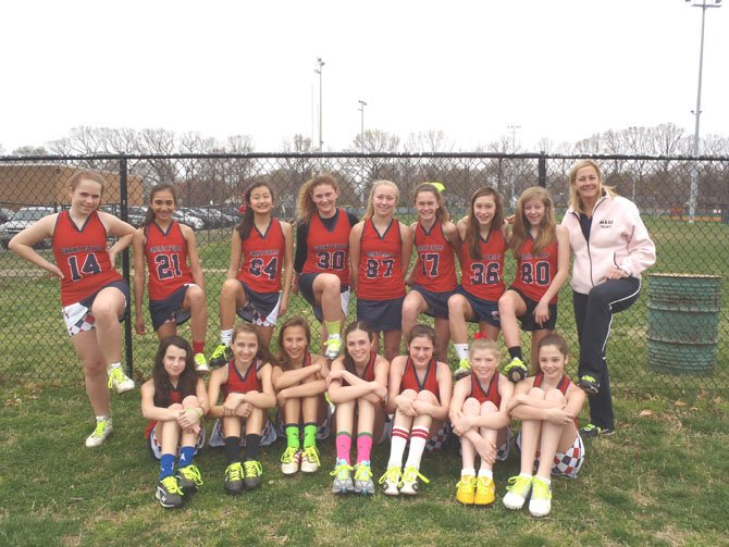 Great Falls Girls U13 Lacrosse team lace-up for pediatric cancer.