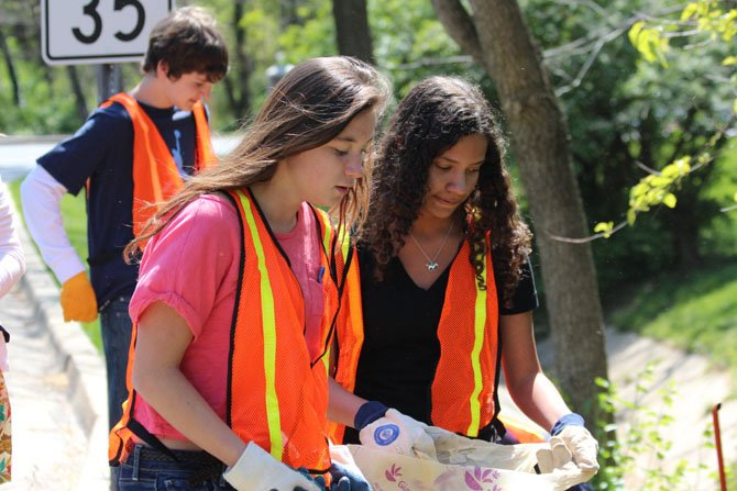 Washington Episcopal School in Bethesda held its annual all-school Community Service Day to give back to the community. Each student and faculty member, as well as parent volunteers, participated in this special day that benefited many organizations and individuals in the area, including Bethesda Cares, Samaritan Ministries, Cabin John Fire Department, hospitalized children, and the Humane Society. Students from the school also collected trash and debris from their adopted highway, Little Falls Parkway, along with Little Falls Creek, and the Capital Crescent Trail. Above, WES eighth-graders clean-up trash and debris on Little Falls Parkway in Bethesda. From left are Richard Royle, Annie Steckler and Sydney Ortega.