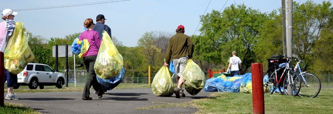 Volunteers return with more sorted trash to the drop-off point on Commonwealth Avenue.