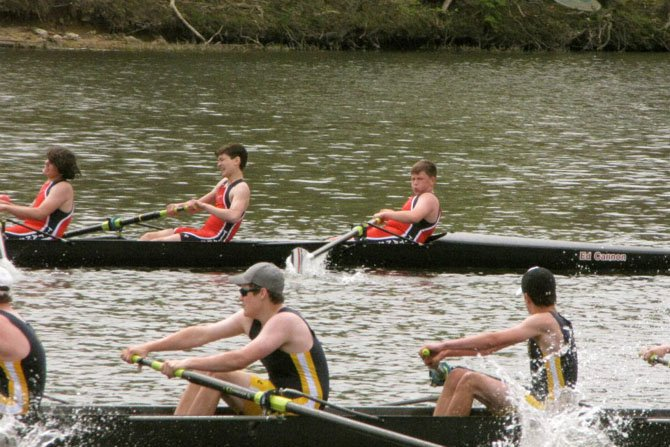 Rower Jack Kane (in the bow seat, top right) stares down the competition as the T.C. Williams boys' freshman 8 storms past Bethesda-Chevy Chase on their way to victory at the Darrell Winslow Regatta on April 14.