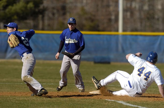 Robinson sophomore Jake Pinkston makes a slide into second base during a Rams' early season baseball scrimmage game versus South Lakes.