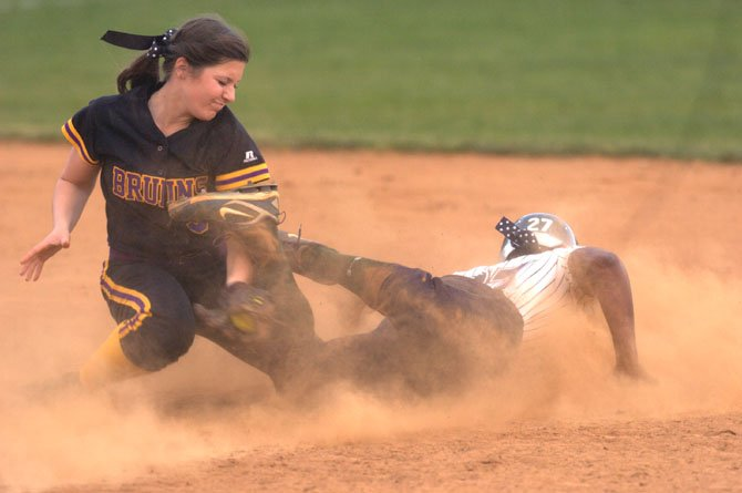 Lake Braddock shortstop Mallory Gerndt attempts to tag South County's Whitney Burks during the teams' April 17 meeting at Lake Braddock Secondary School.