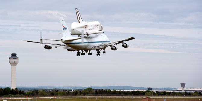 "The Space Shuttle Discovery, atop its Boeing 747 carrier, prepares to end its last flight at Dulles International Airport on Tuesday, April 17. The shuttle will become part of the Smithsonian Institution's permanent collection at the Steven F. Udvar-Hazy Center in Chantilly. The flight was referred to as ""flight 905 heavy"" on the air traffic control channel."