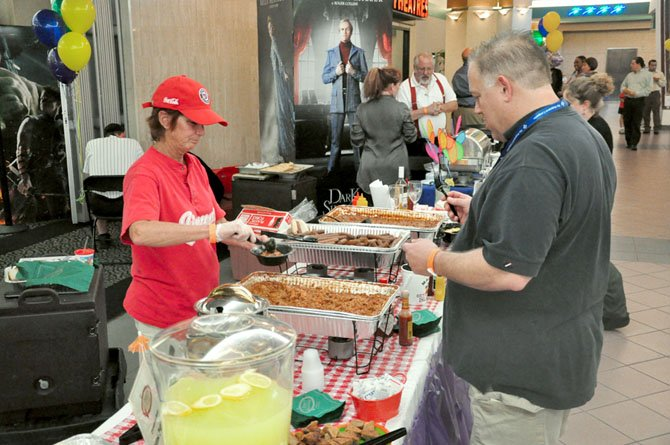 Buzz Rider samples some jambalaya from Jimmy's Old Town Tavern during the annual Taste of the Town event at Worldgate Thursday, April 19.