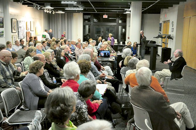 Reston founder Robert Simon tells stories from his early life at the Reston Community Center Lake Anne Thursday, April 19.