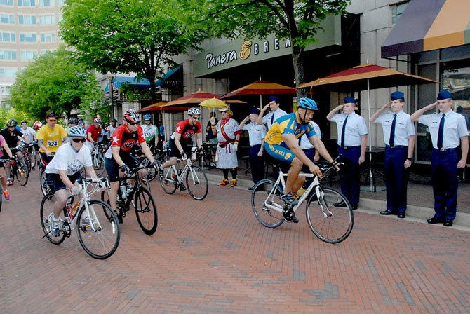 Alexander leads the riders out of Reston Town Center for the start of the 53-mile ride. Standing at attention were members of the Battlefield High School JROTC (Junior Reserve Officer Training Corps), from Haymarket.