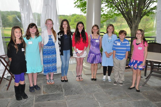 From left, Great Falls Elementary students Rachel Vanderven, Maddie Cross, Sabrina Barker, Nicole Medina, Hannah Femia, Laura Gersony, Olivia Garner, Nicholas Trunnell and Sonia Toloczko, winners of the annual Great Falls Friends and Neighbors Poetry Contest.