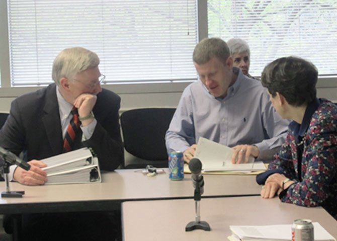 Supervisor John Foust (D-Dranesville) confers with Supervisors Jeff McKay (D-Lee) and Linda Smyth (D-Providence) before the budget mark-up session on Friday, April 20.