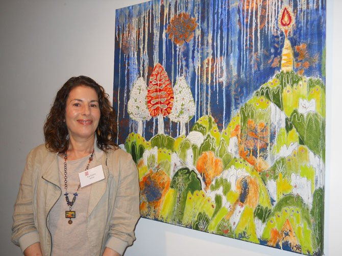 "Artist Joy Every with her acrylic and oil painting titled ""Beacon."""