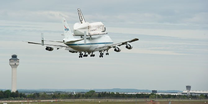 The Space Shuttle Discovery, atop its Boeing 747 carrier, prepares to end its last flight at Dulles International Airport on Tuesday April 17. The shuttle will become part of the Smithsonian Institution's permanent collection at the Steven F. Udvar-Hazy Center in Chantilly.