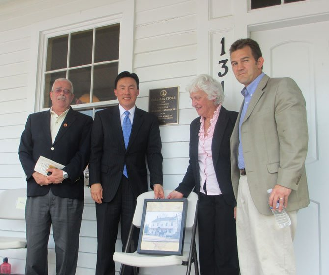 U.S. Congressman Gerry Connolly, Virginia Delegate Mark Keam, Mayor M. Jane Seeman and Virginia Senator J. Chap Petersen celebrate the unveiling of the Freeman Store plaque commemorating its historical designation in the Commonwealth.
