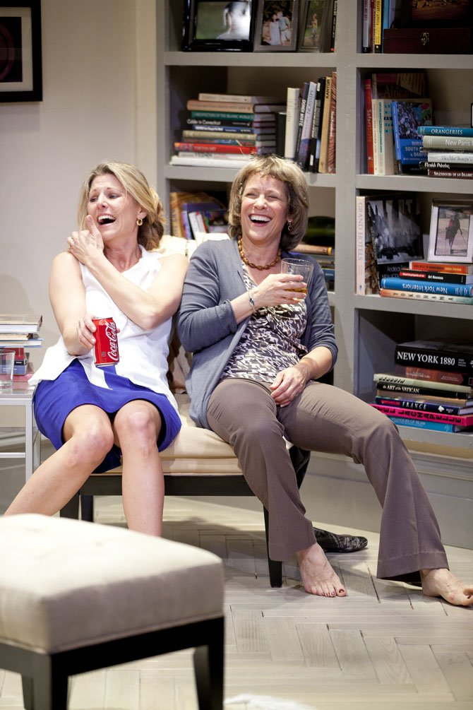 Vanessa Lock (left, as Annette) and Naomi Jacobson (as Veronica) share a laugh and a drink in the Washington premiere of &quot;God of Carnage&quot;. Playing at Virginias Signature Theatre through June 24. 