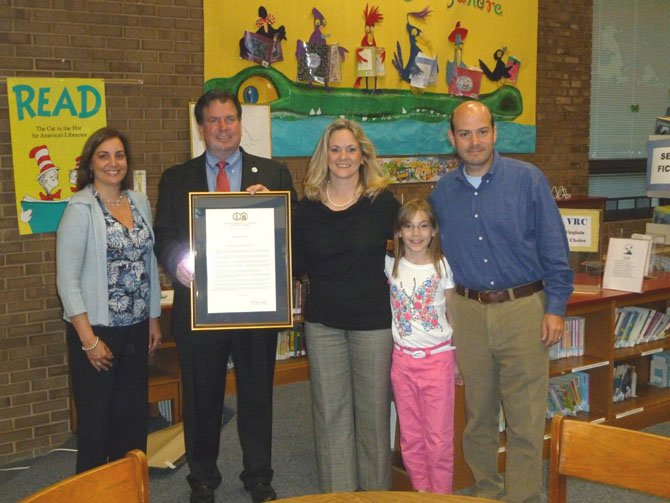 Del. Tim Hugo attended the April PTA meeting at Union Mill Elementary to present Kate Trussell with a proclamation from Gov. Bob McDonnell recognizing her as the Virginia PTA volunteer of the year. Hugo commended Trussell for coordinating our Bread Basket program that made over 11,000 sandwiches for Food for Others last year.  As of this year, students at Union Mill have already made almost 13,000 sandwiches for Food for Others. Above, with Trussell are her husband, Jeff, and daughter, Sarah.