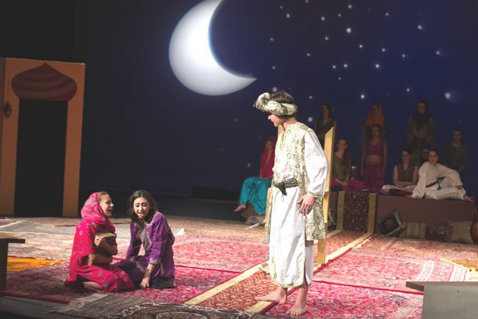 In Lake Braddock Secondary School's production of The Arabian Nights, Elspeth Ripley, 14, as Dunyazade and Elena Dominquez, 18, as Scheherezade plead with captor Shahryar, portrayed by Tony Talcott, 14 to spare Scheherezade's  life.