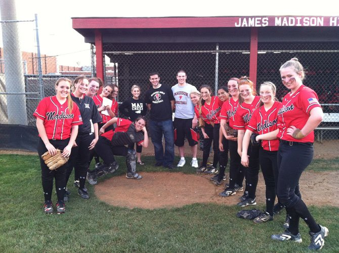 Madison High teachers (center, back) Colleen McAuley, Dan Grossman, and Mike Bath pose with members of the Madison softball team last Friday evening prior to pre-game `Teacher Night' festivities. A fourth Madison teacher, Ryan Douds, was unable to attend the evening's ceremonies.