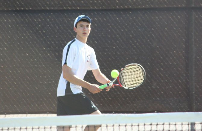 Madison High's Alex Russell (pictured) competes in his No. 6 singles match versus Langley's Brian Niu on April 16 at Madison.