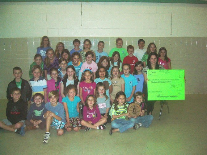 The Stratford Landing Elementary School K-Kids Club (sponsored by Mount Vernon Kiwanis) collected a total of $4,144.37 last month for a project called Pennies For Patients. This is about $1,400 more than last year's collection. The collection is a Leukemia and Lymphoma Society community service project where students and their friends donate their spare change to fund blood cancer research and patient aid programs. Above, the K-Kids present a symbolic check to the representative from the Leukemia and Lymphoma Society, Joann Hatch (shown on right).