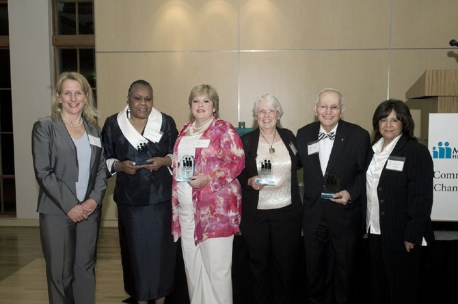 Four Northern Virginia volunteers receive Community Champions Awards for their service to the community. Pictured are: Dr. Jean Glossa of Fairfax County Community Health Care Network; Mattie Palmore and Kari Warren of Mount Vernon; Marie Markey of Alexandria; Ed Shahin of McLean; and Gloria Calderon of Molina Medical Group.