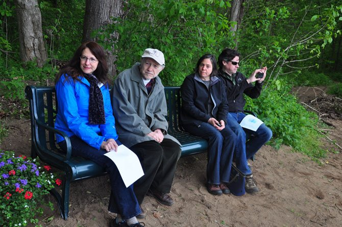 From left, Karen, Frederick, Jennifer and Christopher Weck sit on the bench at Riverbend Park dedicated to Eleanor Weck, founder of the Great Falls Trailblazers.