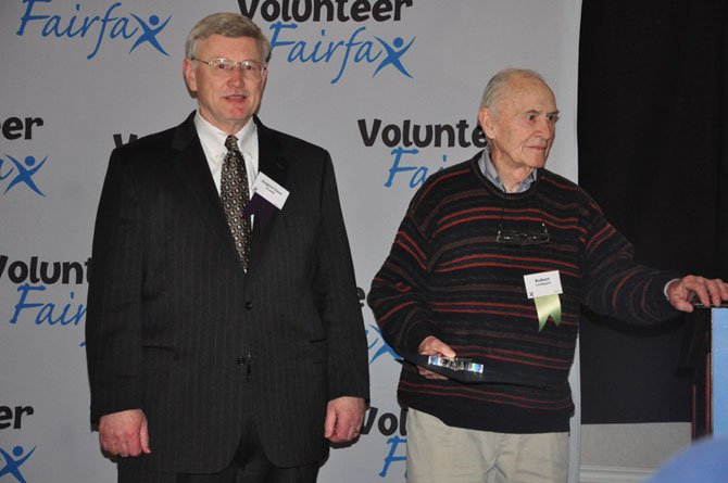 From left, Supervisor John Foust (D-Dranesville) awards Great Falls resident Bob Lundegard Community Champion for the Dranesville District Friday, April 27 at the Fairfax County Volunteer Service Awards.