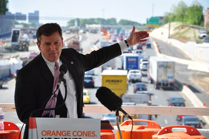 Virginia Secretary of Transportation Sean Connaughton speaks about the importance of stopping distracted driving on the Westpark Drive bridge in Tysons Corner Wednesday, April 25.