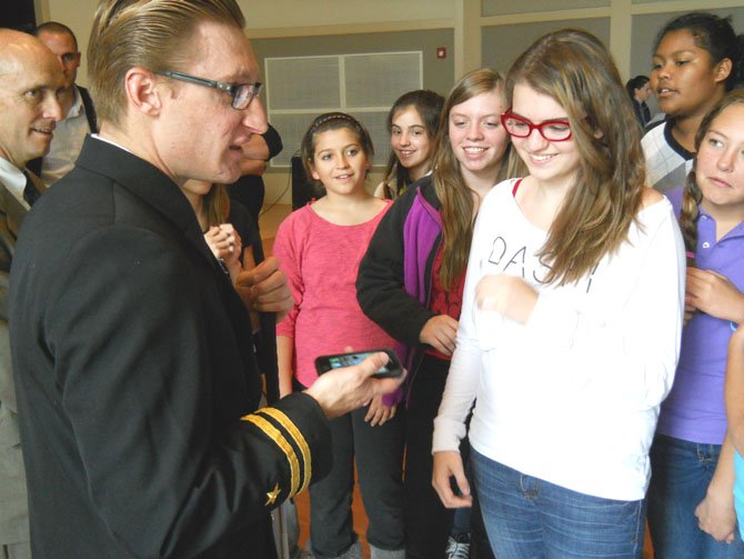 Students were impressed with Lt. Snyder's smart phone, which has many applications for the blind.