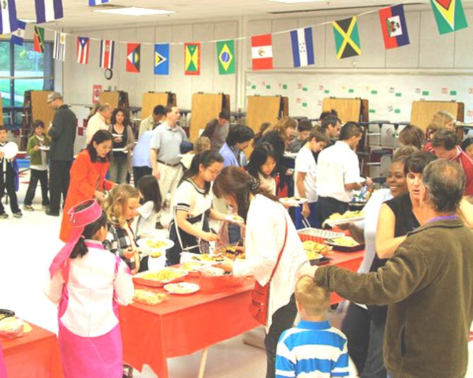 Churchill Road students, their parents and staff members enjoy the many ethnic foods prepared by families for the school's annual Parade of Cuisines.