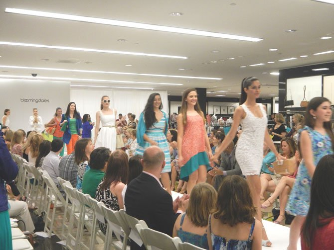 "Walking the runway in Bloomingdale's ""must-have selection"" for the spring season was a mix of professional models and young volunteers from the D.C. branch of Childhelp Wings."
