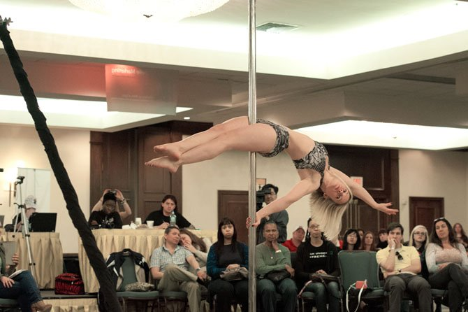 Mary Flemming of Chantilly, a competitor in the Ms. Virginia Pole Dance America Fitness Competition on April 28 at the Crystal City Hilton, demonstrates extreme strength, flexibility and stamina during her routine in the compulsory round.