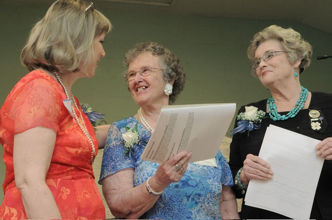 Barbara Kiker, past president, Northern District GFWC (2010-2012), presents club president Lucille Cressey with the General Federation of Women's Club's of Virginia, Legislative and Policy/ Best GFWC Small Club — for Legislation and Policy 2012. The award was for hosting U.S. Rep. Jim Moran (D-8) and Chris Zimmerman, Arlington County Board chairman (March 2011) as a program for the March 7, 2011 meeting. Both came to the clubhouse and informed the group and guests what was happening on the local and national level. The club won the Northern District GFWC award earlier this year. Also pictured is Hope Royer, president, General Federation of Women's Clubs of Virginia.