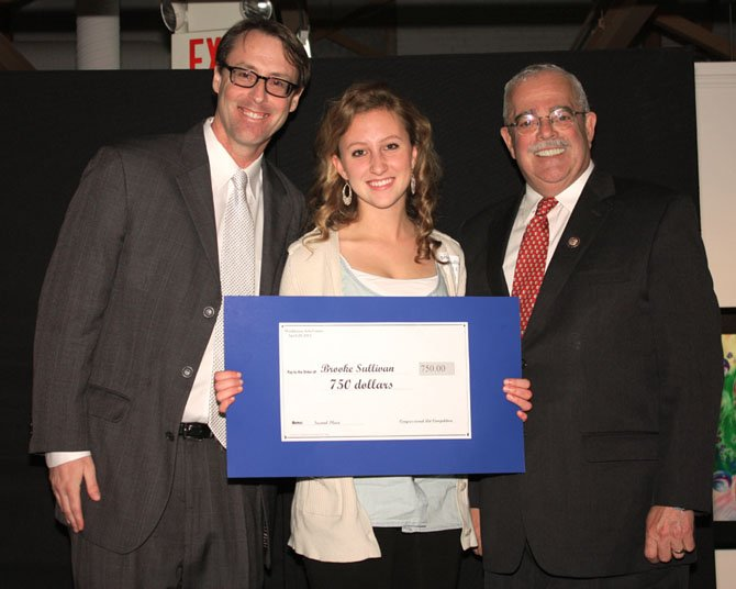 U.S. Rep. Gerry Connolly presents Brooke Sullivan of Paul VI High School 2nd prize in the congressional art competition. On the left is Scott Habes, Director of Visual Arts, Lorton Arts Foundation,