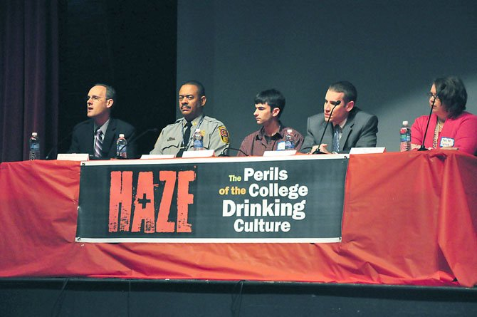 From left, Dr. William Hauda, an emergency room physician at INOVA Fairfax Hospital, Capt. Bruce Ferguson, commander of the Fairfax County Police Department's Youth Services Division, Ryan Smith, a graduate student at Virginia Tech, Casey Lingan of the Commonwealth's Attorney's office and Mary Ann Sprouse, director of Alcohol, Drug and Health Education at George Mason University address parents and students at Herndon High School Tuesday, April 24.