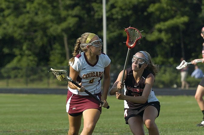 Oakton's Kelsey Clarke, with the ball here in last year's state finals versus Madison, has been one of the Cougars' top players this spring.