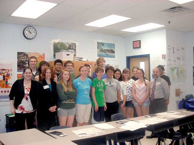 West Potomac High School students from Frances Coffey's Advanced Placement Human Geography class were treated to a visit from Cathi Hoefler and Steven Keating from the National Geospatial Intelligence Agency recently. Hoefler and Keating discussed the importance of using data to better predict and respond to natural disasters such as Hurricane Katrina and the 2011 earthquake off the coast of Japan and tsunami.  Students asked questions about how relief efforts are influenced by geography.  The speakers also discussed how understanding cultural values and norms is important in military efforts worldwide.