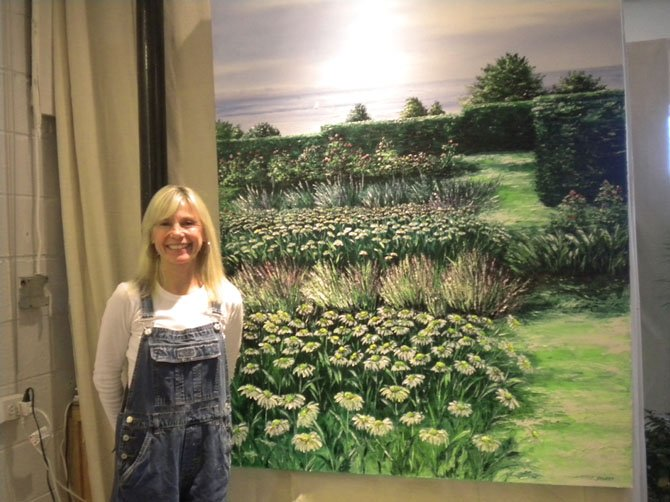 "Artist Claire Howard and her painting ""Seaside Garden."""
