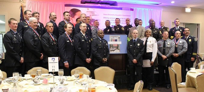 Valor Award winners pose for a group photo following the awards ceremony April 26 at the Crowne Plaza Hotel.