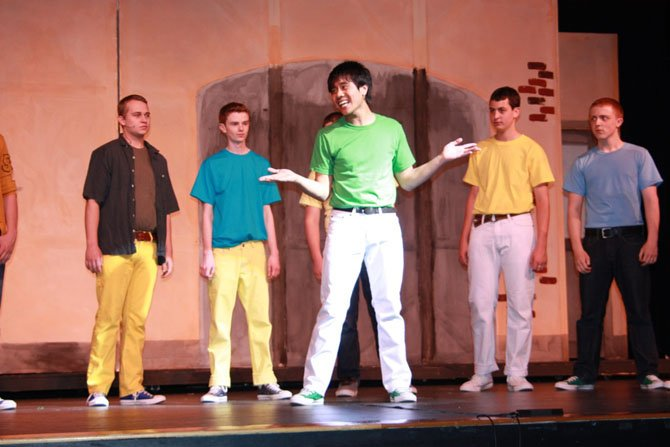 "Nikko Custodio (Riff) performs ""The Jet Song"" while the other Jets look on (From left, back: Alex Fischer as Diesel, Jack Gereski as Action, AJ Lichstrahl as Gee-Tar, Chris Celentano as Redman)."