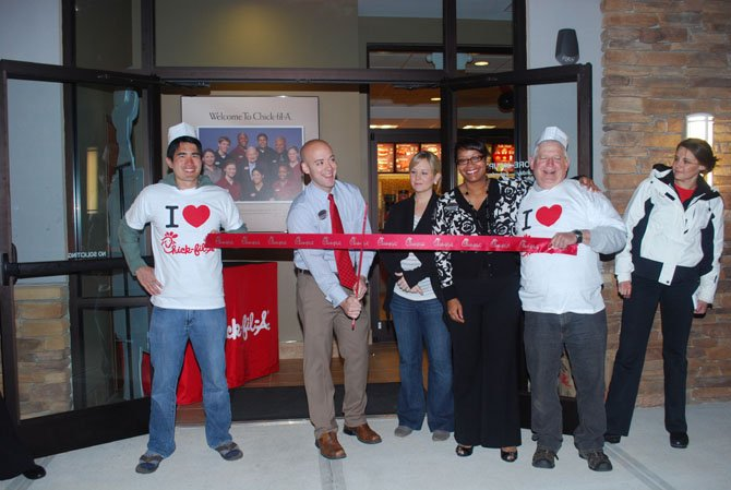 From left: Scott Inouye, number one of the first 100 in line; Joe Engert, owner of Chick-fil-A, cutting the ribbon; Daniel Engert, Joe's wife; Juliet Hall, business consultant of Chick-fil-A; and Gerry Webb, number 100 from the first 100 in line.