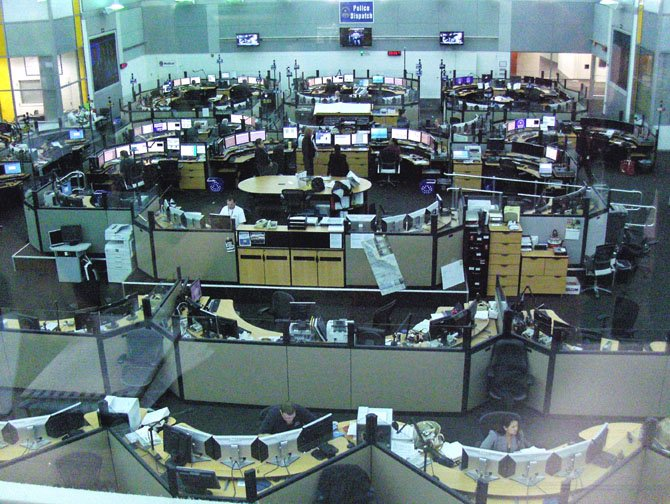 A bird's-eye view of the EOC operations floor for Fairfax County 911, police and fire dispatchers, VDOT and State Police inside the McConnell Public Safety and Transportation Operations Center.