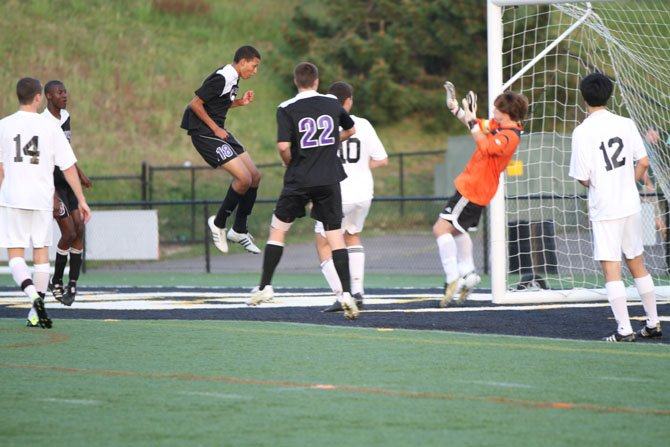 Chantilly sophomore Nick Ullom, in the air, scores on a header shot to give the Chargers an early 1-0 lead over Westfield. Chantilly, in the Concorde District game played on April 26 at Westfield, went on to win 4-0. No. 22 for Chantilly is senior midfielder Anton LeKang.
