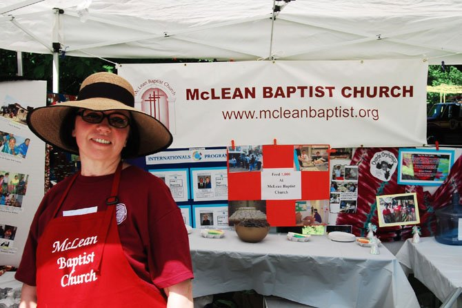 Community organizations, such as McLean Baptist Church, provide friendly greetings and a bounty of free information and goods to festival goers.