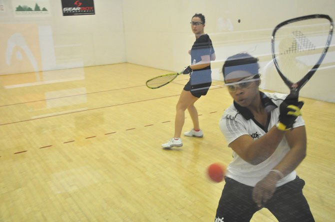 Damonique Davis hits a rebound shot during her match with Brandi Jacobson Prentice at Worldgate Sport and Health Friday, May 4, part of the Women's Professional Racquetball Tour's event.