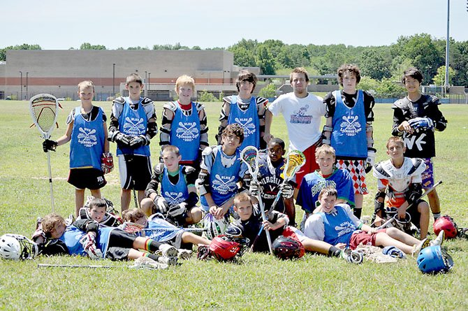 South Lakes lacrosse standout Nolan Boyle (top row, third from left), nicknamed 'Team Nails,' shares time with youngsters during last summer's South Lakes Lacrosse Camp.